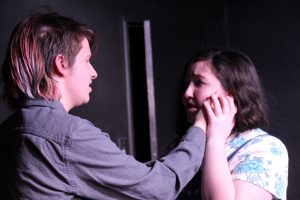 Hamlet (Jimmy Coblin) delivers 'to be or not to be' after murdering Polonius to Ophelia (Grace Randall).